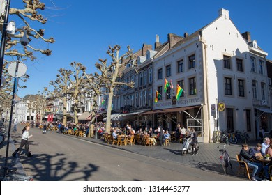 Maastricht, Limburg Netherlands - 02/15/2019 First rays of sun in Maastricht in Spring and people go outside to enjoy the feeling on a terrace with a beer