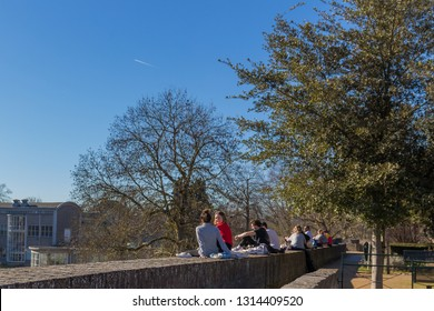 Maastricht, Limburg, Netherlands 02/15/2109: students enjoying th first sun at the fortified wall in Maastricht