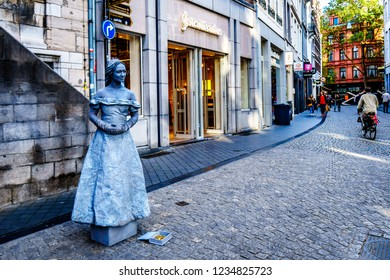 Maastricht, Limburg / the Netherlands -  Sept. 21, 2018: Living art statue of a girl in a grey dress in the center of the historic city of Maastricht