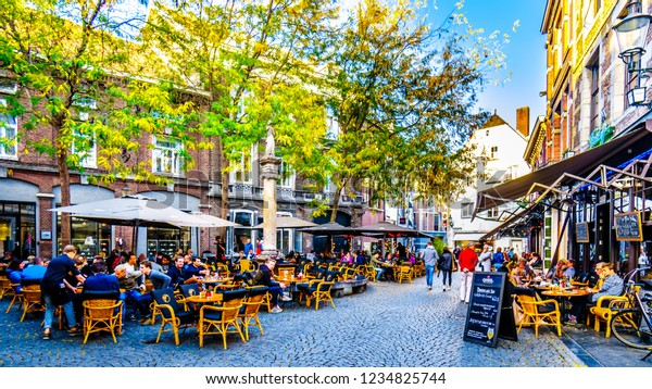 Maastricht, Limburg / the Netherlands -  Sept. 21, 2018: Many restaurant and pub terraces and patios to hang out with friends in the center of the historic city of Maastricht in the Netherlands