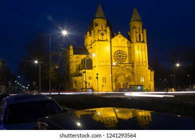 Maastricht, Limburg/Netherlands; 11/26/2018 Saint Lamberthus church in Maastricht during the blue hour on a cloudy autumn evening with the reflection of the church in a car