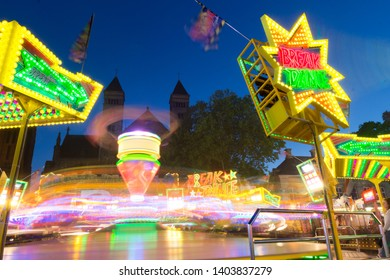 Maastricht, Netherlands 05/15/2019 Fun fair at Vrijthof square in Maastricht with spectacular attractions during the annual celebrations of the birhday of Saint Servaas with the church in the back