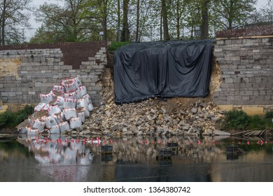 Maastricht, the Netherlands 09/05/2019 13th century fortified collapsed wall in Maastricht, trying to save the wall with big sand bags and black plastic in order to not get more movements