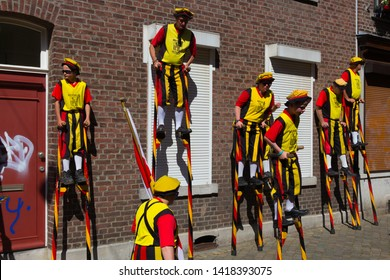 Maastricht, Netherlands 6/2/2019 Koninklijke Steltlopers Merchtem (Royal stilts walkers from Merchtem, Belgium) during a parade in downtown Maastricht. The stilts reach a height of 4 meters