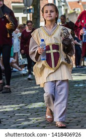 Maastricht, Netherlands 6/2/2019 a little girl with her baby owl being part of a Falconers group during the medieval parade in downtown maastricht