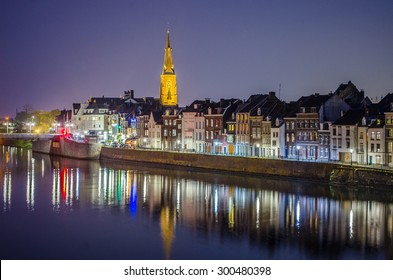 MAASTRICHT, NETHERLANDS, APRIL 12, 2014:Night view over riverside of Meuse in Maastricht.