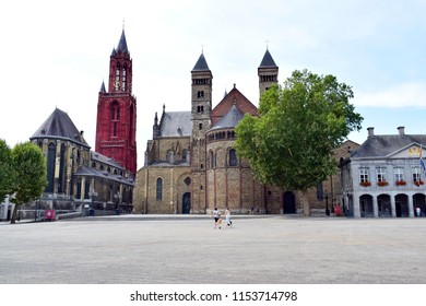 MAASTRICHT, NETHERLANDS - August 01, 2018: The ancient Vrijthof Square with the Saint Servatius Basilica and the St John Church on sunny day, very olden monastery history in Maastricht, Netherlands .