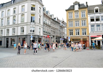 MAASTRICHT, NETHERLANDS - August 01, 2018: Unidentified people walking on sidewalk and enjoy shopping in street center ,this place is one of the famous shopping center in Maastricht, Netherlands.