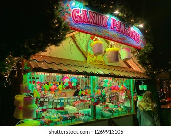 Maastricht, The Netherlands - December7,2018: Candy and toy shop at Christmas night market in Maastricht, Limburg