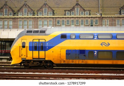 Maastricht, The Netherlands - February 22, 2015: Waiting yellow with blue Nederlandse Spoorwegen train in the city center.
