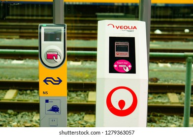 Maastricht, The Netherlands - February 22, 2015: Modern Veolia and NS card reading machines with display at a train station in the city center.