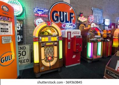 MAASTRICHT, NETHERLANDS - JANUARY 14, 2016: Various retro jukeboxes and retro refrigerator Coca-Cola. International Exhibition InterClassics & Topmobiel 2016