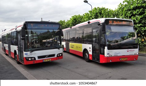 Maastricht / Netherlands - July 9 2016: Two red / white busses of Veolia in the Netherlands : a Volvo 7700 and a VDL Ambassador bus
