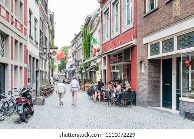 MAASTRICHT, THE NETHERLANDS - june 10, 2018: Tourists on foot Graben Street Maastricht, Netherlands.