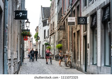 MAASTRICHT, THE NETHERLANDS - june 10, 2018: Tourists on foot Graben Street Maastricht, Netherlands.