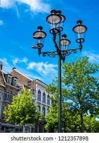 MAASTRICHT, NETHERLANDS - JUNE 15, 2013: A pair of Nike sneakers hanging by the laces from a street lamp, a shoe dangling