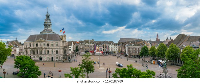 Maastricht, The Netherlands - June 16th 2018, Tourist and locals wander around on the historic 'Markt' square with the town hall in the center of town