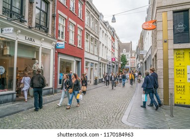 Maastricht, The Netherlands - June 17th 2018, People shopping at 'Grote staat' shoppingstreet in the center of Maastricht