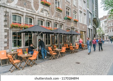 Maastricht, The Netherlands - June 18th 2018, people enjoying a drink at the terrace of a restaurant in the historic center of Maastricht
