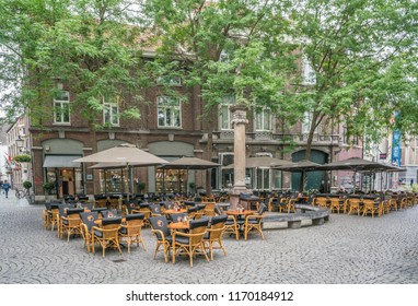 Maastricht, The Netherlands - June 18th 2018, Empty terrace at the 'Sint Amosrplein' in the center of Maastricht waiting for costumors