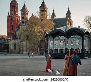 Maastricht, Netherlands - June 9, 2019: Women stand before the Basilica of Saint Servatius, a Roman Catholic church in the city of Maastricht, the Netherlands.