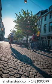 Maastricht, Netherlands - June 9, 2019: Cyclers in the city of Maastricht, Netherlands. In this country the use of bikes is highly encouraged.
