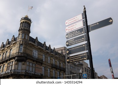 Maastricht, Netherlands - Mar 23, 2015: A guidepost standing on the square of Maastricht Railway Station.