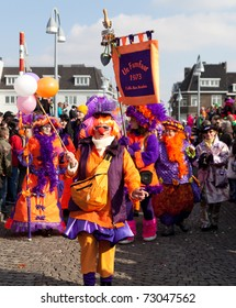 MAASTRICHT, THE NETHERLANDS - MARCH 6: Unidentified men and women in the Carnival parade on March 6, 2011 in Maastricht, The Netherlands. This parade is organized every year with about 100,000 visitors.