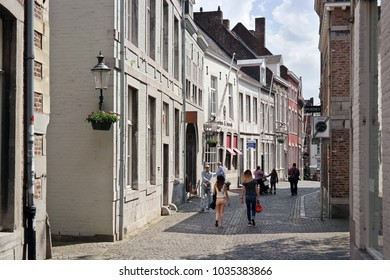 MAASTRICHT, THE NETHERLANDS - MAY  13, 2016: Pedestrian zone, shopping district in the Stokstraat part of the ancient Maastricht city centre.