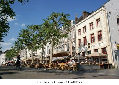 MAASTRICHT, THE NETHERLANDS - MAY 13, 2016: Sidewalk cafes on Vrijthof Square. The Vrijthof is a square in the inner city of Maastricht, is the largest square in the center of the capital of Limburg.