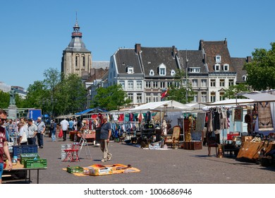 "MAASTRICHT, THE NETHERLANDS - MAY 27, 2017: The ""Markt"" (Market square), crowded with people and stands selling a diversity of goods on a sunny day."