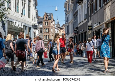 MAASTRICHT, THE NETHERLANDS - MAY 27, 2017: Kleine Straat (Small Street) crowded with people shopping on a sunny day.