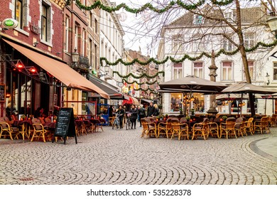 MAASTRICHT, THE NETHERLANDS - NOVEMBER 22, 2016: Dinner tables of bars and restaurants with christmas lights on the Sint Amorsplein square in Maastricht, The Netherlands