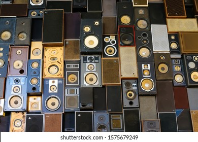 Maastricht, Netherlands - November 30. 2019: Vintage speaker wall: View on isolated stack of many vintage retro loudspeakers