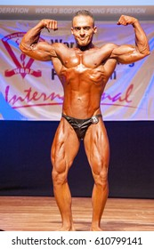 MAASTRICHT, THE NETHERLANDS - OCTOBER 25, 2015: Male bodybuilder flexes his muscles and shows his best front double biceps double biceps pose at the World Grandprix Bodybuilding and Fitness