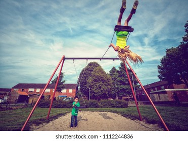 MAASTRICHT-JULY 8: Children play on the swing on the first day of the Summer holiday on 8 July 2017, in Maastricht, The Netherlands. The Dutch National Summer holiday starts from 8 Juli till 20 August
