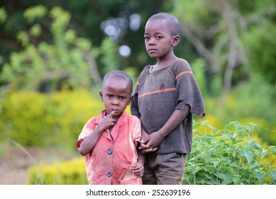 MABAMBA SWAMP, WAKISO DISTRICT/UGANDA  MAY 24, 2014: Waiting for their father to return with food for the family, young unidentified brothers wait in a small fishing village in Uganda.