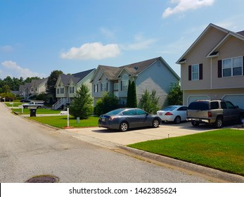 Mableton, Georgia, USA - July 5, 2019: beautiful residencial street with houses along the street and cars parked at Mableton.