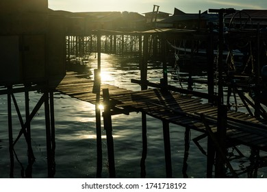 Mabul Island, Sabah, Malaysia - August 08, 2018: The beautiful sunlight with a golden color at the floating village at Mabul, island