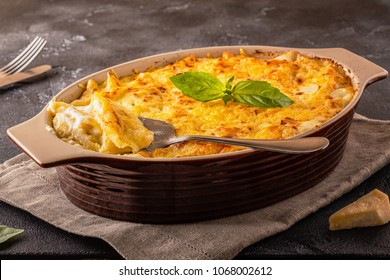 Mac and cheese, american style macaroni pasta in cheesy sauce, selective focus.
