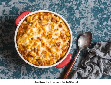 Mac and cheese. Macaroni and cheese with meat tomato sauce. Delicious lunch