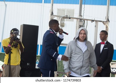 Mac Miller attemtps to walk off stage after forgetting his rhymes. Jay Electronica encourages him to stay at the Brooklyn Hip Hop Festival 10th Year Anniversary in Brooklyn New York on July 14, 2014