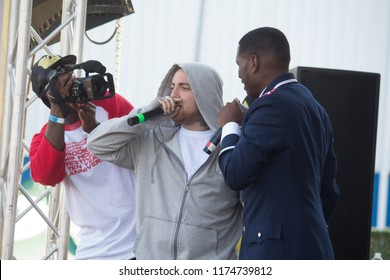 Mac Miller freestyles with Jay Electronica on stage at the Brooklyn Hip Hop Festival 10th Year Anniversary in Brooklyn New York on July 12, 2014.