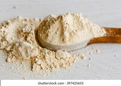Maca powder on wooden spoon