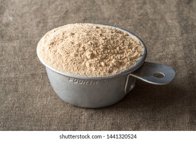 Maca Root Powder in a Measuring Cup