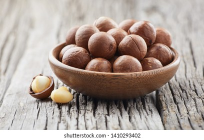 Macadamia nuts on wooden background