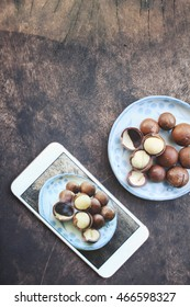 Macadamia nuts with smart phone