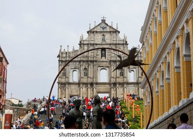 Macao, China - Feb. 3, 2019: Ruins of St. Paul, iconic Church facade and religious museum, tourists enjoy their holidays.China has launched the Guangdong-Hong Kong-Macao Greater Bay Area plan.