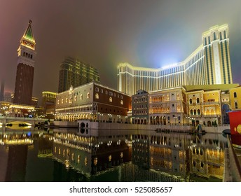 Macao, China - March 8, 2016: Venetian Macau Casino and luxury resort in Macao, China. Late in evening. Illuminated with golden light