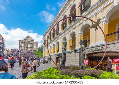 MACAO, CHINA - NOVEMBER 16, 2015: Ruins of St. Paul, iconic Church facade and religious museum, tourists enjoy their holidays.China has launched the Guangdong-Hong Kong-Macao Greater Bay Area plan.